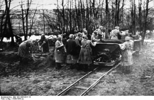 Women prisoners working at Ravensbruck. [PD-USA]